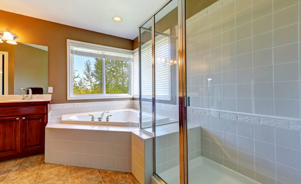 Bathroom Interior With Corner Bath Tub And Screened Shower